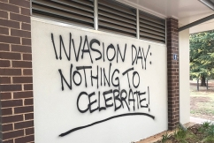 Patriotic couple paint over disgusting Australia Day graffiti