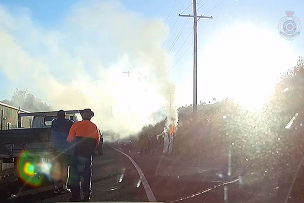 Article image for WATCH | Heroic QLD cops pull man from burning car