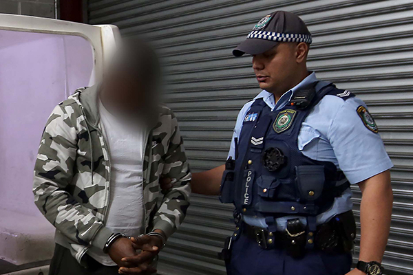 Article image for Police bust $3-million scam ring run out of Villawood Detention Centre