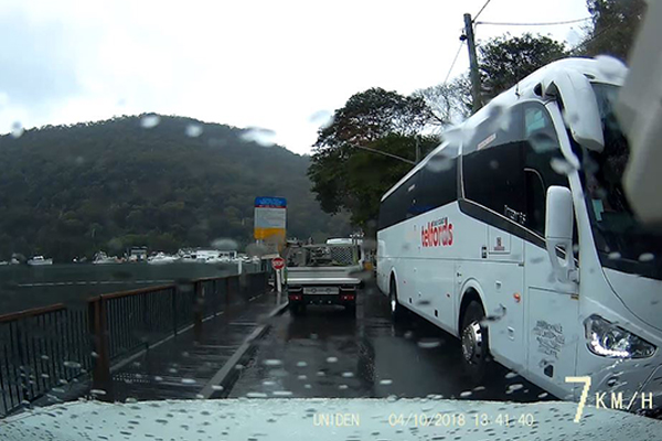 Article image for Coach bus ignores road signs, smashes three windows