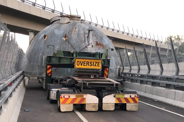 Article image for Oversized truck trapped for hours after becoming wedged on off-ramp