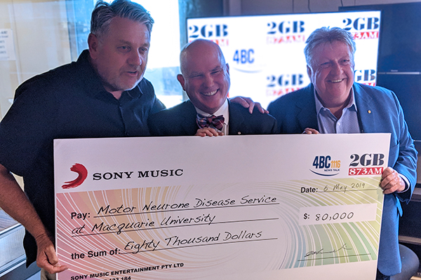 Article image for Ray Hadley presents another huge cheque for the fight against MND