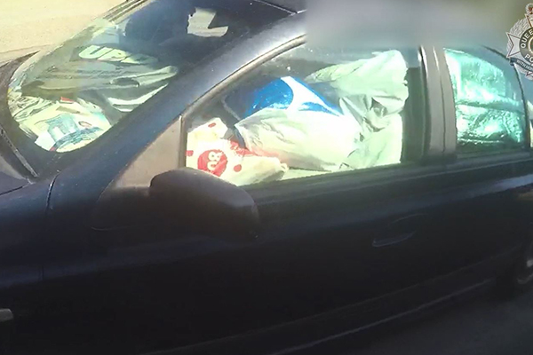 Article image for WATCH | QLD man fined for driving car filled with garbage