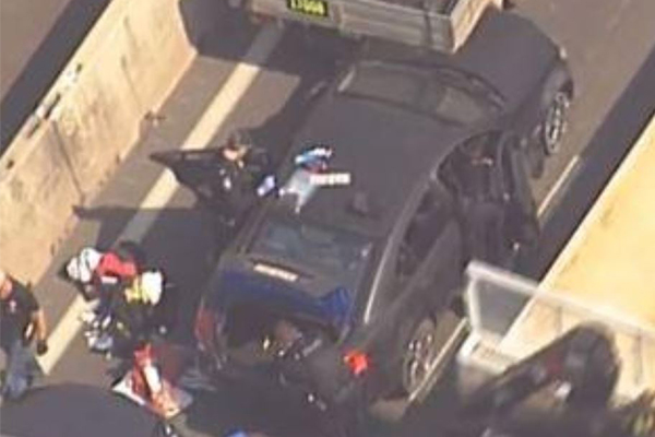 Article image for High-speed chase of car with no tyres ends in crash on Bruce Highway