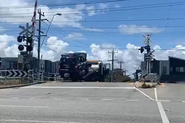 Article image for WATCH | Tow truck narrowly avoids being cleaned up by train