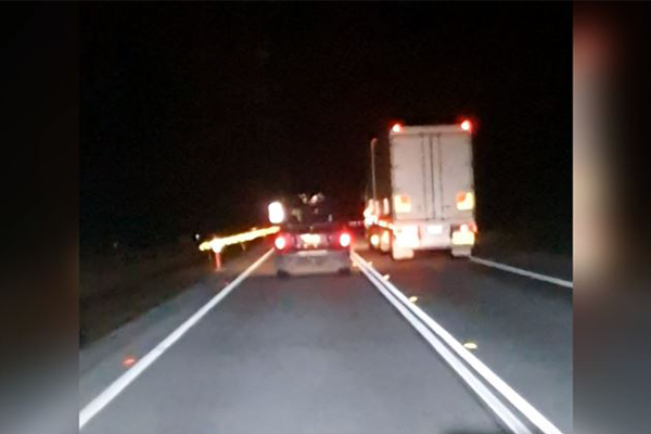 Article image for WATCH   Truck caught driving on the wrong side of the Pacific Highway