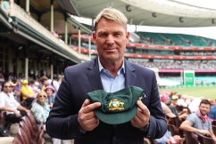 Shane Warne auctions off prized baggy green for bushfire relief