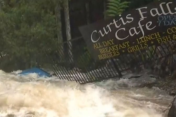Article image for Streets turned into rivers as huge deluge falls on south-east Queensland