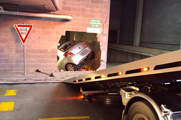 Article image for Car smashes through wall at Sydney Woolworths