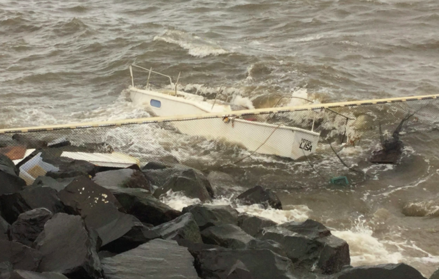 Article image for Mystery boat washes up on rocks in coastal town