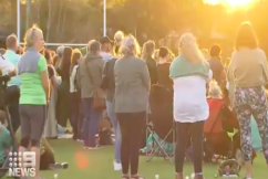 Gold Coast community comes together for candlelight vigil for Kelly Wilkinson