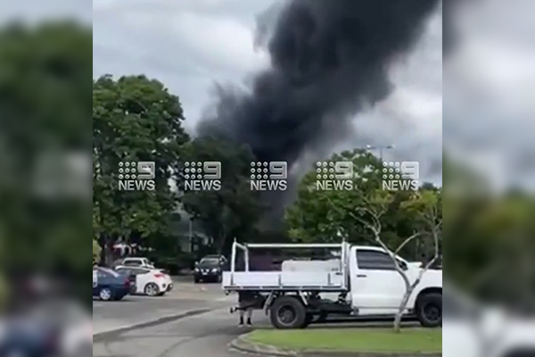 Article image for Warehouse in flames spilling plumes of black smoke in Burleigh Heads