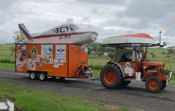 Article image for Why a man is driving a tractor and towing a plane around Australia