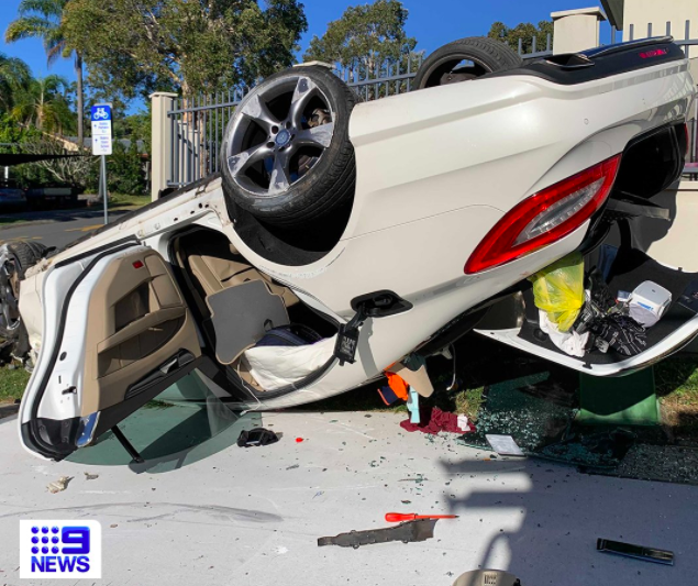 Article image for Car flips after hitting fence in Robina