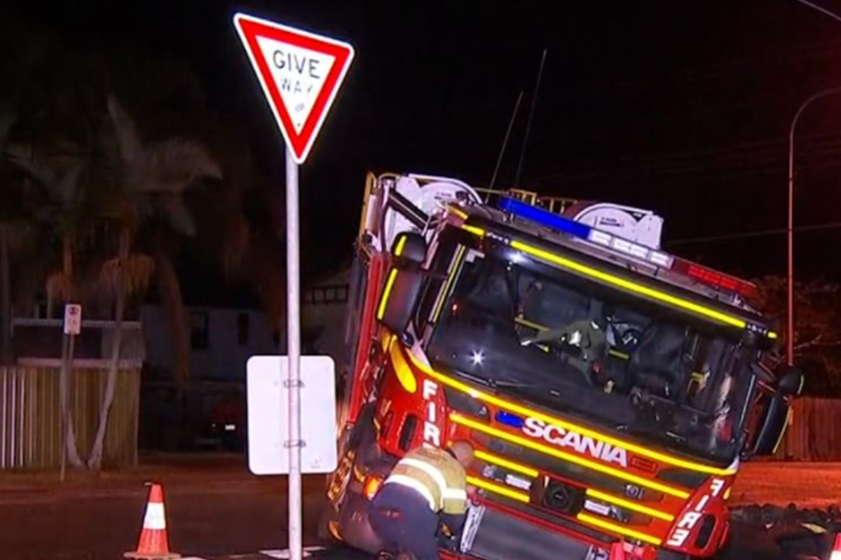 Article image for Sinkhole erupts in Greenslopes, drags firetruck down